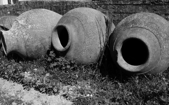 Romans used clay amphoras (talhas de barro) to make wine which is still in use today in Portugal and referred to as the Alentejo style wine.