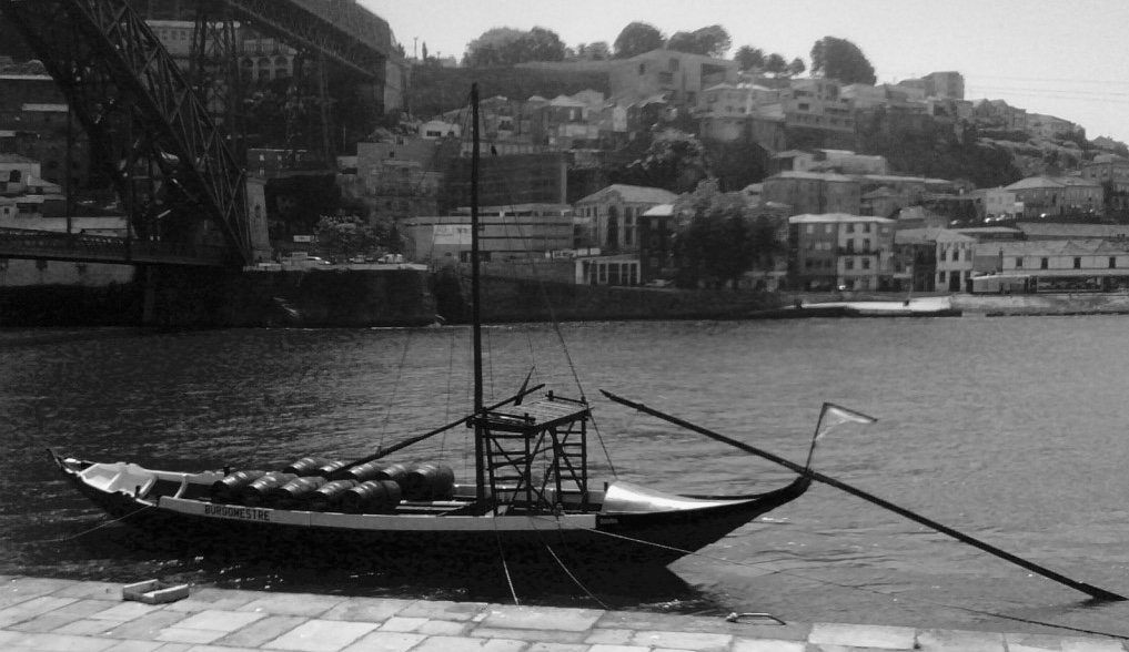 A rabelo boat (barco rabelo) was used to transport port wine from the Douro Valley to the city of Porto. While they are used today only for dsplay and cultural activities, they add to the historical significance and landscape in the area.